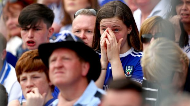 Monaghan fans look dejected during the All-Ireland Senior Football Championship quarter-final between Monaghan and Kerry at St Tiernach's Park, Clones. Photograph: ©INPHO/James Crombie