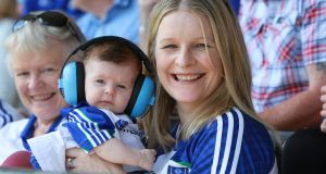 Áine Kerr with her family at the All-Ireland Senior Football Championship quarter-final between Monaghan and Kerry in Clones. Photograph: Peadar McMahon