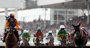 Riders compete in the Latin Quarter Beginners' Steeplechase during day two of the Galway races. Photograph: Brian Lawless/PA Wire