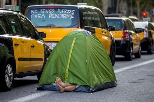 STRIKE OR SIESTA? A man takes a rest in a tent next to several parked taxis in downtown Barcelona, northeastern Spain, as a taxi strike continues in the city. Taxi drivers in several cities have joined colleagues in Barcelona, who started the protests on July 25th. Photograph: Quique Garcia/EPA