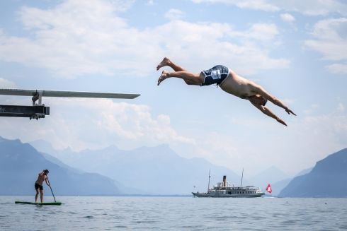 GO JUMP IN A LAKE: A man dives into Lake Geneva at Saint Saphorin, western Switzerland, as a heatwave continues to grip northern Europe. Photograph: Fabrice Coffrini/AFP/Getty Images