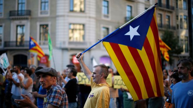 A man holds the pro-independence Catalan flag during a protest in support of Catalonia's imprisoned politicians, in Barcelona. Photograph: AP Photo/Manu Fernandez