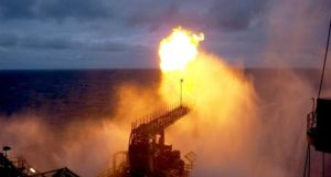 A  gas flare from  a drilling rig during a well production test at the Corrib field, 80km off Co Mayo. Photograph: Shell E&P Ireland Ltd