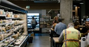 Eating lunch inside The Market, on the ground floor of Twitter's headquarters in San Francisco. A proposed ordinance would ban employee cafeterias in new construction, encouraging tech workers to leave the office to buy their meals. (Photograph: Jason Henry/The New York Times)