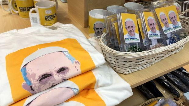 News T-shirts and mugs among some of the range of Pope Francis memorabilia and souvenirs on sale at the Veritas store on Dublin's Abbey Street. Photograph: Bryan O'Brien/The Irish Times