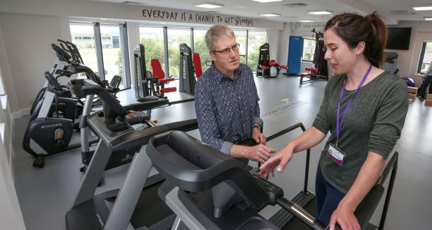 ab5367f142c Physiotherapist Emma Houlihan with recovering patient Tom McCarthy in the  new gym at Cancer Care West s
