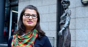 "Tayan Gaedi at the Countess Markievicz Statue on Townsend Street, Dublin 2: ""I tell people now I'm Irish-Kurdish."" Photograph: Cyril Byrne"