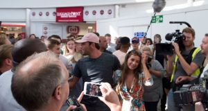 Who dat: Love Island winners Dani Dyer and Jack Fincham slip through Stansted airport unnoticed following the final episode of the reality TV show. Photograph: David Mirzoeff/PA Wire