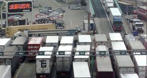 Out of the single market and customs union, every British lorry will have to be checked at French ports for tariffs and standards, bringing cross-Channel traffic to a standstill. (AP Photo/Lynne Sladky)