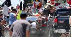 A car  is driven into  protesters demonstrating against a white supremacist rally in Charlottesville, Virginia, on  August 12th, 2017.  One woman, Heather Heyer, died and  19 were  injured. Photograph: AP