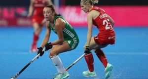 Ireland's Yvonne O'Byrne  turns away from Jo Hunter of England during the Pool B game. Photograph: Christopher Lee/Getty Images