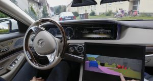 Children and parked cars are colour-coded on a monitor inside a Mercedes S-Class car. Photograph: Michaela Handrek-Rehle/Bloomberg