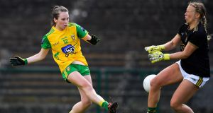 Donegal's  Sarah Jane McDonald has her shot saved by Kerry's Laura Fitzgerald during the clash at Hyde Park  in Roscommon. Photograph: Brendan Moran/Sportsfile