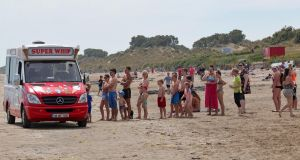 Beachgoers queue for an ice-cream in June. File photograph: Colin Keegan/Collins Dublin