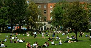 Summer wardrobes can only expand so much. Enjoying the sunshine in Merrion Square, in Dublin. Photograph: Dara Mac Dónaill