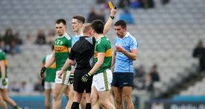 Referee Ciarán Branagan shows Dublin's Niall Scully  a yellow card during the Allianz Football League Division 1 match against Kerry, He received a second yellow later on in the game and was sent off. Photograph: Bryan Keane/Inpho