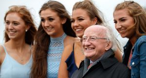 President Michael D Higgins with racegoers at Ballybrit on Wednesday. Photograph: INPHO/James Crombie