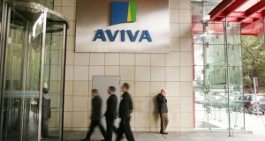 Staff enter the Aviva Offices on Hatch Street in Dublin. Photograph: Alan Betson