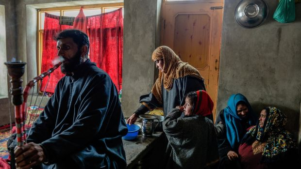 Sameer Tiger's parents, Mohammed Maqbool Bhat and Gulshan Begum, at home in Drabgam, India, in the state of Kashmir. Photograph: Atul Loke/New York Times