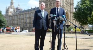 Minister for Justice Charles Flanagan and Minister for Foreign Affairs Simon Coveney hold their press conference on the street after the British failed to provide a room following a meeting of the British-Irish Intergovernmental Conference in London last month. Photograph: Kirsty O'Connor/PA