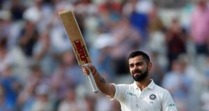 India's Virat Kohli celebrates reaching a century during the First Test against England at Edgbaston. Photograph: Andrew Boyers/Reuters
