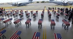 Flag-draped transfer cases with the remains of American soldiers repatriated from North Korea at Joint Base Pearl Harbor-Hickam in Honolulu, Hawaii. Photograph: Ronen Zilberman/AFP/Getty