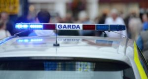 Gardaí sealed off the road for a time in order to conduct a forensic examination. Photograph: Frank Miller/The Irish Times
