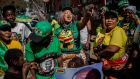 Supporters celebrate after Zimbabwe's president Emmerson Mnangagwa was declared the winner in the country's landmark election, in the Harare suburb of Mbare on Friday. Photograph: Luis Tato/AFP/Getty Images
