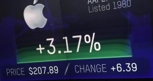 A monitor displays Apple Inc stock information at the Nasdaq MarketSite in New York on August 2nd. Apple Inc. became the first US-based company with a market value of $1 trillion, four decades after it was co-founded by Steve Jobs in a Silicon Valley garage and later revolutionized the worlds of computing, music and mobile communications. Photograph: Peter Foley/Bloomberg