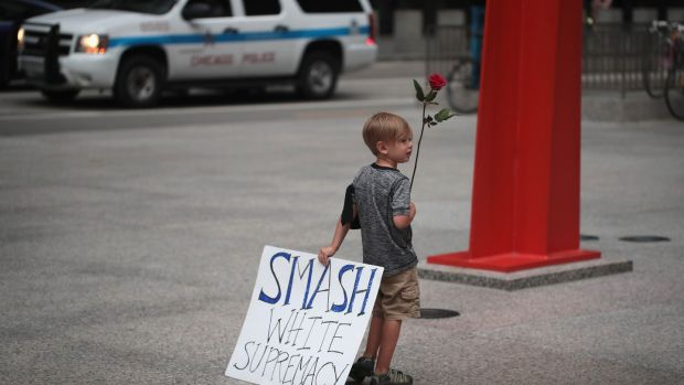 Four-year-old Leo Griffin leaves a protest in Chicago against the alt-right movement held to mourn the victims of thes Charlottesville rally. Photograph: Scott Olson/Getty Images