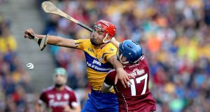 Clare's Peter Duggan is tackled by Galway's Paul Kileen during the drawn semi-final at Croke Park. Photograph: Ryan Byrne/Inpho