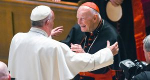 Pope Francis reaches to hug prominent US archbishop emeritus Theodore McCarrick back in 2015:  McCarrick has resigned following allegations of sexual abuse. Photograph: Jonathan Newton/The Washington Post