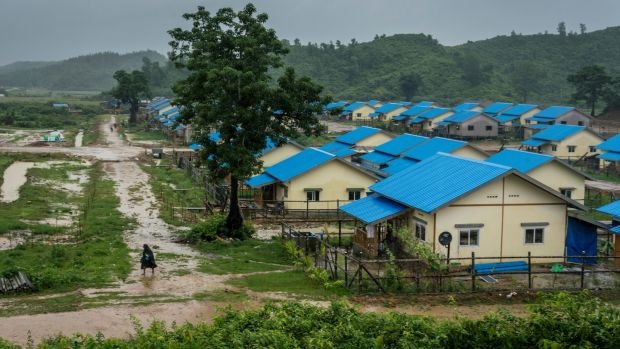A villager walks past prefabricated huts that the Myanmar government said it had prepared for the returning Rohingya Muslims, in Maungdaw Township, Myanmar. Photograph: Adam Dean/The New York Times
