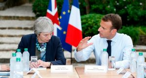 British prime minister Theresa May with French president Emmanuel Macron  at the Fort de Bregancon in  southern France on Friday. Photograph:  Sebastien Nogier/AFP/Getty Images