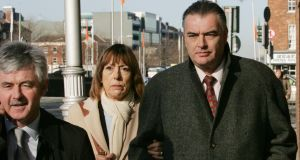 "Ian Bailey and partner Jules Thomas, with solicitor Frank Buttimer:  Mr Bailey says the fact retired gardaí were not obliged to contribute gave them ""immunity in effect"". Photograph: Matt Kavanagh"