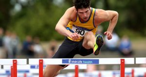 North Down AC's Ben Reynolds winning the  110m hurdles at the National Senior Championships at Morton Stadium in Santry. Photograph: Bryan Keane/Inpho