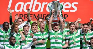 Scott Brown of Celtic lifts the Ladbrokes Scottish Premier League trophy in May.  Photograph:  Mark Runnacles/Getty