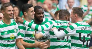 Celtic celebrate after Tom Rogic put the champions 2-0 up against Livingston. Photograph:   Jeff Holmes/PA