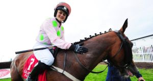 Katie O'Farrell with Low Sun after their victory at Galway on Saturday. Photograph: PA