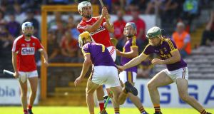 Shane Kingston scores a point for Cork in their Under-21 final win over Wexford. Photograph: Ken Sutton/Inpho