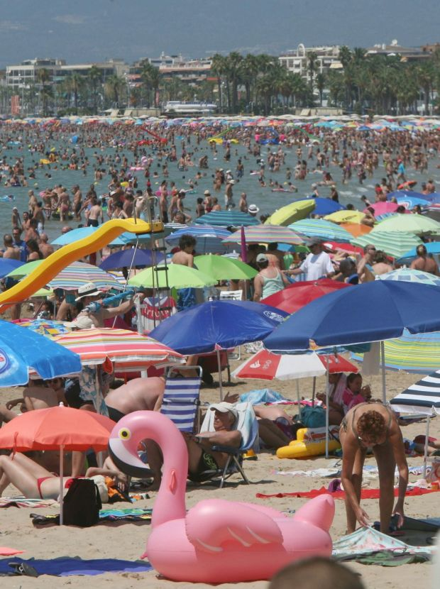 People enjoy the sun and the sea at Levante beach during their holidays in Salou, Catalonia, Spain. Photograph: Reuters