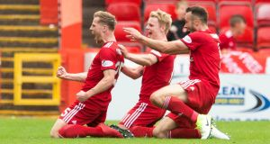Aberdeen's Bruce Anderson (left) celebrates scoring his side's first goal with team-mates during the Scottish  Premiership match against Rangers at Pittodrie. Photograph: Jeff Holmes/PA Wire