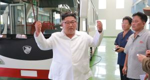 North Korean leader Kim Jong-Un visiting a trial operation of a new type of trolley bus at an undisclosed location in North Korea.  Photograph: KCNA via KNS/AFP/Getty Images