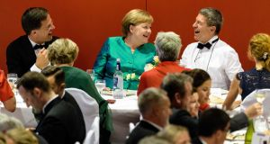 German chancellor Angela Merkel and husband Joachim Sauer (in white) enjoy the music of Richard Wagner in Bayreuth, southern Germany. Photograph: Matthias Balk