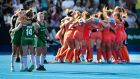 The Irish players embrace after The Netherlands run out winners of the Hockey World Cup. Photograph: Morgan Treacy/Inpho