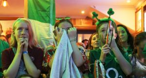 Can't bear to look: Hockey fans watch Ireland's drubbing at the hands of the Netherlands in the World Cup final on Sunday. Photograph: Ronan McGreevy/The Irish Times