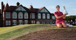 England's Georgia Hall with the trophy after she wins the Ricoh Women's British Open at Royal Lytham & St Annes Golf Club. Photograph: Richard Sellers/PA Wire