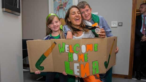 Ellie and Arthur Sheane from Glenely, Wicklow greet Lena Tice during the arrival of the Irish women's hockey team at Dublin Airport following the Hockey World Cup Final. Photograph: Gareth Chaney/Collins