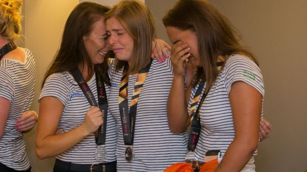 Yvonne O'Byrne, Katie Mullen and Lena Tice during the arrival of the Irish women's hockey team at Dublin Airport following the Hockey World Cup Final. Photograph: Gareth Chaney/Collins