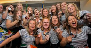 Members of Ireland women's hockey team arrive at at Dublin Airport following the Hockey World Cup Final. Photograph: Gareth Chaney/Collins